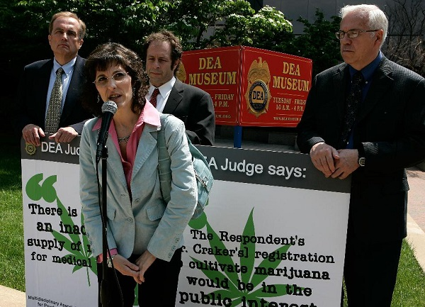 ARLINGTON, VA – MAY 23: Medical marijuana user Angel Raich (2nd L) of Oakland, California, speaks as (L-R) clinical neurologist Denis Petro, Rick Doblin, President of the Multidisciplinary Association for Psychedelic Studies, and Lyle Craker, professor of plant and soil science of University of Massachusetts, look on during a news conference in front of the headquarters of U.S. Drug Enforcement Administration to call on the administration to accept the recommendation from a DEA administrative law judge to end the federal monopoly on the supply of marijuana that can be used in FDA-approved research May 23, 2007 in Arlington, Virginia. Angel Raich, 41 suffers from an inoperable brain tumor as well as several other complex medical conditions and began using medical marijuana to ease pain and gain appetite after her doctor suggested it in 1997. Coming from a conservative upbringing, Angel didn't feel comfortable using an illegal substance, especially in front of her children. Raich sued U.S. Attorney General John Ashcroft and Drug Enforcement Administration director Asa Hutchinson to block them from interfering with her medical marijuana use and to avoid drug charges and arrest. Angel lost her case and appeal. She is now preparing to undergo treatment for her brain tumor. (Photo by Alex Wong/Getty Images)