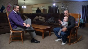 Jeff Mizanskey holds his great-granddaughter, Arreia, while at the dinner table with his family in Sedalia, MO.