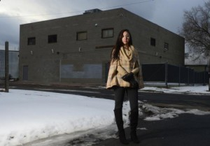 Community organizer Candi CdeBaca stands outside a Denver warehouse that is used for marijuana cultivation on Dec. 22, 2015. (Brent Lewis, The Denver Post)