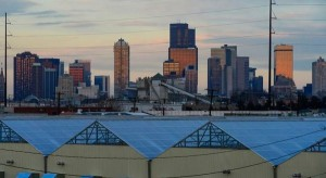 The background of the Denver skyline sits above Greenwerkz grow houses on the 800 block of Wyandot Street on December 30, 2015 in Denver, Colorado. One of the fears of the legalization of marijuana was that pot businesses would find places to call home in low income, mostly minority neighborhoods, which according to some is exactly what happened. (Brent Lewis, The Denver Post)