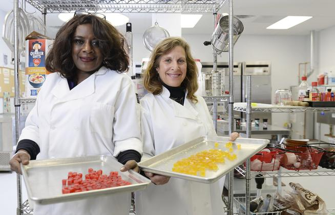 Owners Deloise Vaden, left, and Elyse Gordon show off marijuana edibles in the kitchen of their business, Better Baked, in Denver. (Cyrus McCrimmon, The Denver Post)