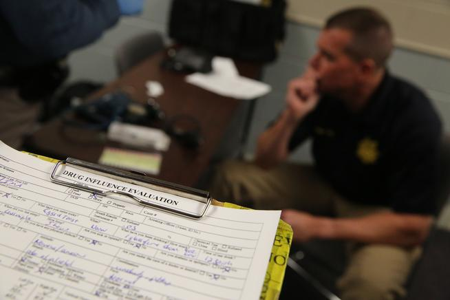 Sgt. David Blatner sits near a completed roadside Drug Influence Evaluation sheet on a clipboard, at the Colorado State Patrol Training Academy, in Golden, Colo., Thursday March 6, 2014. (Brennan Linsley, Associated Press file)