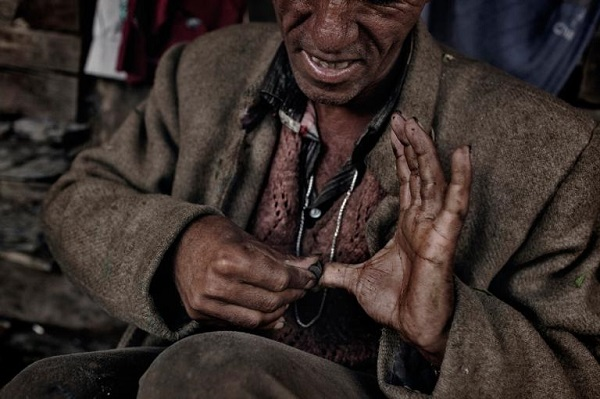 Villagers produce a valuable type of hashish called charas by rubbing parts of the still-living cannabis plants on their hands, then collecting the resin from their palms. PHOTOGRAPH BY ANDREA DE FRANCISCIS