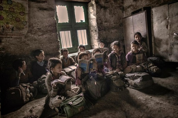 After a few years of education, many children seeking more advanced studies will walk to other villages—somtimes hours away. PHOTOGRAPH BY ANDREA DE FRANCISCIS