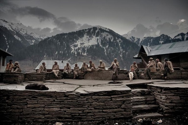 Elders sit in the village square near the temple. They were part of the first generation to cultivate and harvest the wild cannabis grown in the village today. PHOTOGRAPH BY ANDREA DE FRANCISCIS