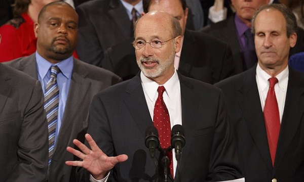 Tom Wolf speaks at a ceremony where he signed the medical marijuana bill. Photograph: Daniel Zampogna/AP