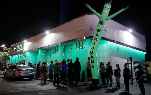 People line up at the NuLeaf marijuana dispensary in Las Vegas on July 1st, 2017. John Locher/AP