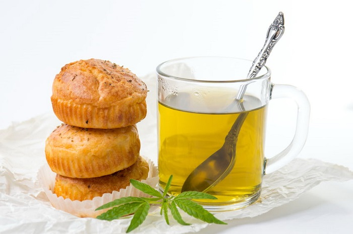 69790295 - marijuana cupcake muffins and hot cannabis tea