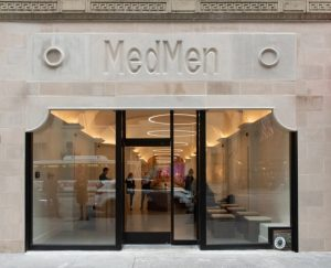 For a store devoid of shoppers, MedMen still feels busy with activity and people.